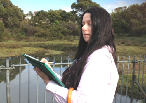 Effie Kotronakis from the Friendly Grocer in Glebe Point  Rd filling-in the survey sheet for the birds identified and counted in the wetlands in Federal Park adjacent to Chapman Rd (image: Judy Christie).