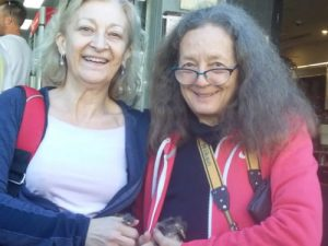 Diana Lauzi and Kim Hague-Smith with two Red Wattlebird nestlings found in St Johns Rd Glebe