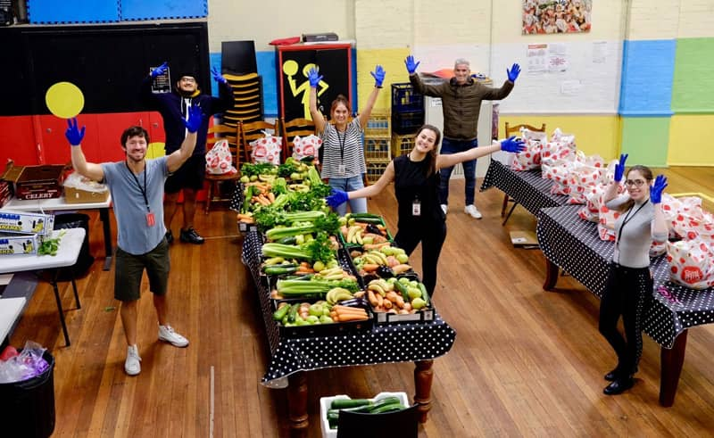 Glebe Youth Service with volunteers organising food relief.