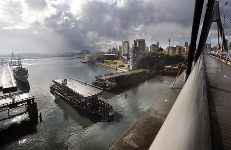 Glebe Island Bridge, built 1903, with Sydney Harbour Bridge in the background. Photo taken from the Anzac Bridge in 2013. (image: Phil Rogers)