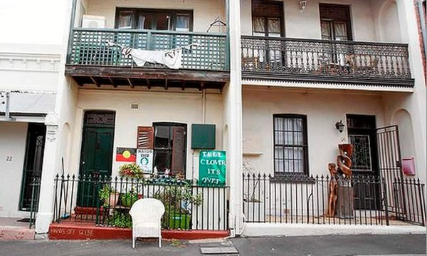 Will Glebe be next?  A Department of Housing home (centre) between two other houses in Glebe. (Photo: Brianne Makin)