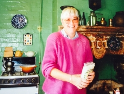 Jane in the kitchen at No 11 Darling St (image: Jude Paul)