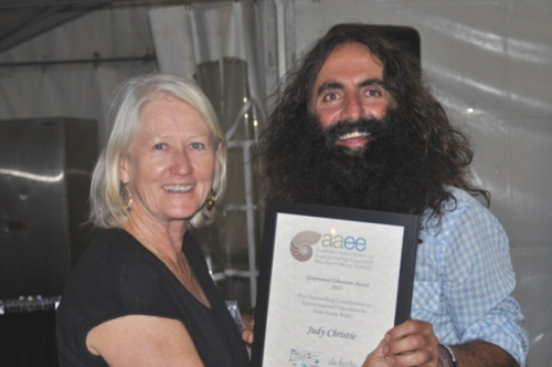 Judy Christie receiving her award from Costa Georgiadis, landscape architect and the host of the ABC TV's Gardening Australia (image: Australian Association for Environmental Education)