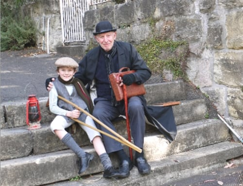 'Tiny Tim and Scrooge' in costume on the steps of Leichhardt Ave in front of Eltham. (Photo: Patricia Baillie)