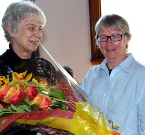 Jan Macindoe presents Lesley with a bunch of flowers following her election as a Life Member.