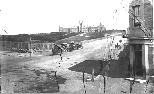 A damaged photo of the road to Parramatta (corner of Bay St) at about the time Henry Butters was publican of the University Hotel. Two horse-drawn omnibuses can be seen. Sydney University is on the skyline.  (image: Mitchell Library)